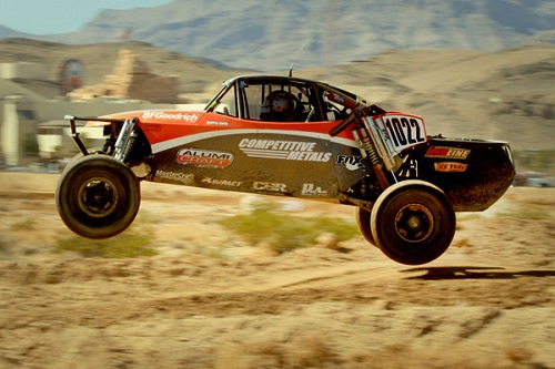 <img src= &quot;class_10_buggy.jpg&quot; alt= &quot;red and black class 10 Alumi Craft buggy catches air as is competes in another desert race&quot; />
