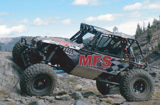 "<img src= ""comp_buggy.jpg"" alt= ""the MFS rock competition buggy prepares to mount massive boulders"" />"