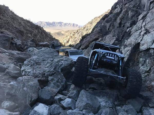 <img src=&quot;ny2019.jpg&quot; alt= &quot;a group of off road vehicles make their way up a rocky trail together&quot; />
