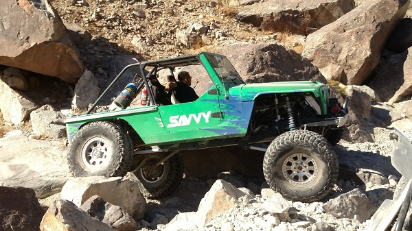 "<img src=savvy.jpg"" alt text= ""Savvy built Jeep wheels in the rocks"" />"